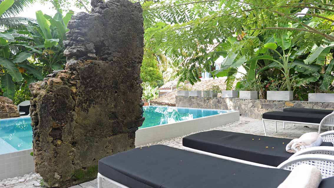colonial-bungalow-Pool-deck-with-Antique-walls