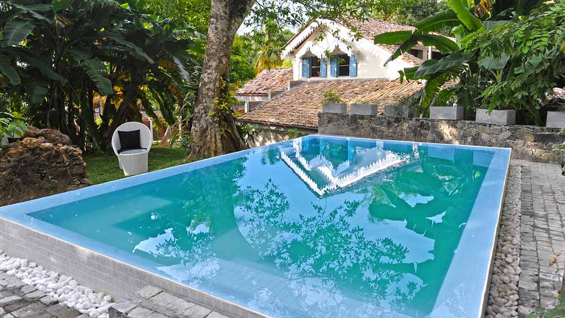 colonial-bungalow-Pool-with-a-view-of-the-House